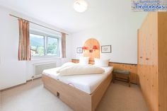Familiensuite im Appartmenthaus Tirolerhaus, Walchsee, Tirol Bed, Furniture, Home Decor, House, Decoration Home, Stream Bed, Room Decor, Home Furnishings, Beds