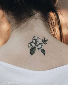 Jasmine tattoo on the back of the neck.