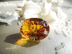 Golden hue of concave cut Golden Citrine, oval shape..Like the rays of Sun, bringing light to somber sky...illuminates sad eyes.