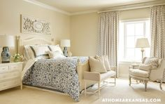 Master bedroom with neutral color palette and blue and white bedding, via @sarahsarna.