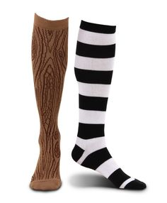 Mismatched Pirate Socks with Wooden Leg - Ever wanted to become a pirate and have that characteristic wooden leg? Well, now you can with our clever mis-matched Pirate Socks. Each adult sized sock is knee length. One is of black and white stripes, whilst the other is designed to resemble wood. It is a nutty brown colour with darker brown detailing to look like the knots and rings seen in natural wood, and so, when worn, it creates the illusion of having a 'peg leg'. #yyc #costume #legwear