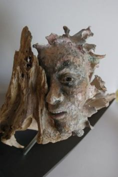 Raku clay, wood and metal. Green Man Faces, Busts, Heads, Torsos sculpture by artist Marlene Kawalez titled: 'Flow (figurative Driftwood and ceramic Face sculpture/statue)' Driftwood Sculpture, Lion Sculpture, Ceramic Sculptures, Find Objects, Green Man, Male Face, Wood And Metal, Sculpting, Skull