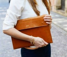 Honey colored leather, MacBook case. Great for bringing you laptop to school, work, the coffee shop, or cafe.