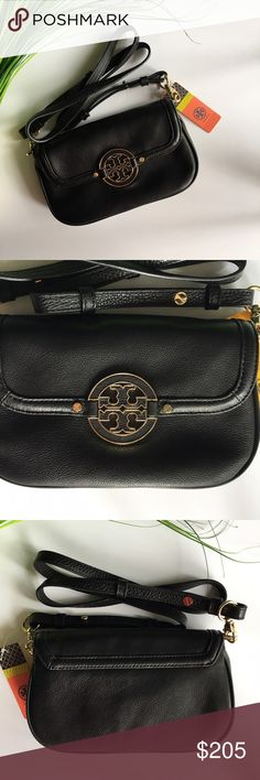 | Tory Burch | Amanda Crossbody Bag Tory Burch Amanda Crossbody Bag. Black. Crossbody cut from pebbled leather handles everyday wear. Easily transition to evening attire by removing the adjustable strap. Hidden-magnetic closure. Optional, adjustable strap. Three interior card slots. Leather. Tory Burch Bags Crossbody Bags