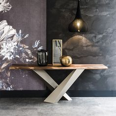 stratos | news - Console with base in titanium (GFM11), black (GFM73) or graphite (GFM69) embossed lacquered steel. Top with irregular solid wood edges in Canaletto walnut (NC), burned oak (RB) or natural oak (RN) 4cm thick.