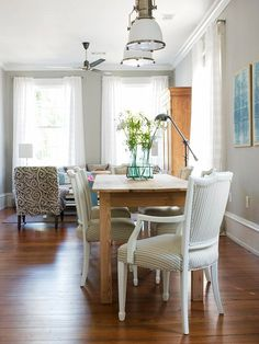 Examples of dining rooms in small-spaces...grays, whites, black, natural wood, bare floor...