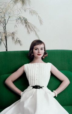 1956 Model is wearing a white cotton pique dress by Teena Paige, patent leather belt by Elegant, gloves by Superb and pearl earrings and bracelet by Marvella.
