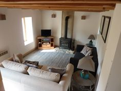 Cosy Lounge with woodburner looks very comfy just a bit of colour needed