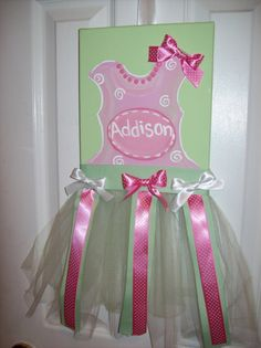 Cute and easy!!!  Canvas, paint, tulle, and ribbon combine to make a decorative organizer for all your little girl's hair accessories.