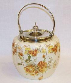 ANTIQUE FLORAL CERAMIC & SILVER PLATE BISCUIT BARREL OR COOKIE JAR