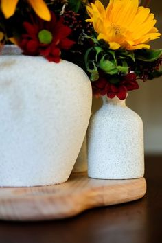 Want stone vases on a budget?  Check out this easy DIY that transformed mixed matched vases into a modern, cohesive look.