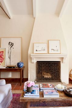 A beautiful and minimal fireplace in a Spanish hacienda featured in Reese Witherspoon moving HOME AGAIN. Get the Look! Interior Design Ideas from HOME AGAIN. Home Again, Reese Witherspoon House, Mantel Styling, Murs Clairs, Living Room Furniture, Living Room Decor, Log Furniture, Antique Furniture, Oversized Coffee Table