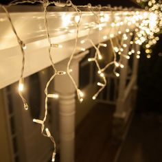 Hang warm white icicle lights outdoors and inside too! So cozy for bedroom accent lighting or winter wedding decor!