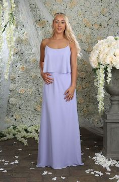 Style 20847 in an elegant lilac chiffon colour from the A4 Hilary Morgan swatch book has an angelic scoop neck and square lined back with spaghetti straps, the bodice of the dress overlays the skirt of the dress yet still maintains the graceful floor length sheath silhouette