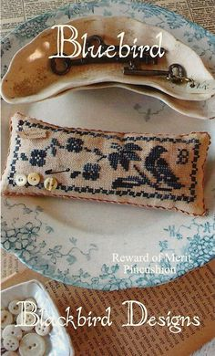 SALE -- Primitive Folk Art Cross Stitch Pinkeep Pattern:  BLUEBIRD -- Blackbird Designs. $4.00, via Etsy.