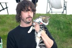 Who says rockstars don't love cats? Dave Grohl with his adorable kitty.
