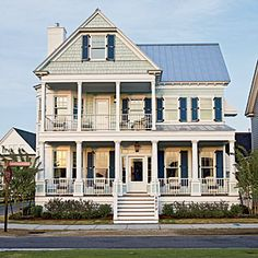 Aqua walls,  navy shutters and double-decker porches complement the waterside surroundings of Coastal Living's 2011 East Beach Idea House in Norfolk, VA | CoastalLiving.com