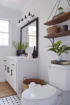 Modern bathroom decor ideas black and white bathroom with wood accent modern farmhouse decor delightfully chic . Diy Bathroom Decor, White Bathroom, Bathroom Interior, Budget Bathroom, Bathroom Ideas, Bathroom Remodeling, Bathroom Lighting, Remodeling Ideas, Simple Bathroom