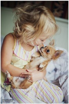 Sweetest picture ever. She loves her little dog and he loves her!!!!!