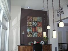 Tree of Life, residential installation.  Handmade, sgraffito-carved ceramic  wall tile by Natalie Blake