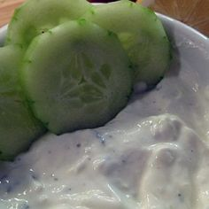 Simple Tzatziki: One 16 oz container of non-fat Greek yogurt  Save Now 1 sprig of fresh mint, finely chopped 1 garlic clove, peeled and grated ½ large cucumber or 1 small cucumber, peeled and grated Zest of ¼ lemon and juice of ½lemon Salt and freshly ground black pepper, to taste *In a serving bowl, combine all of the ingredients and mix well. Taste & reseason as necessary.
