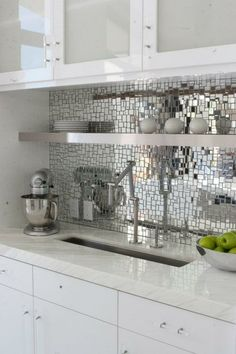 mirror mosaic back splash. neat idea, but not sure how annoying it would be to keep clean...