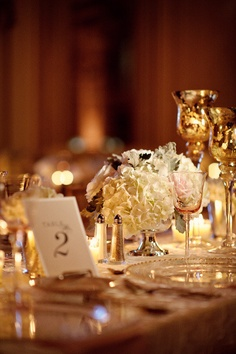 Gold and blush.  Ha - this is almost exactly what my table will look like... Different table numbers.