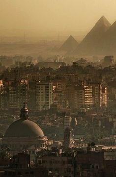 The Great Pyramids in Cairo. The dome in the foreground is that of Cairo University.