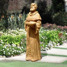 "St. Francis with Robin Feeder 29"" $99.00 This St. Francis statue is cast from a real wood carving for an authentic wood look. It is both functional and beautiful and is built to complement outdoor living with feathered friends. Weight 8 lbs."