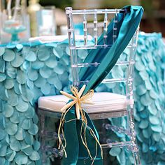 That is one seriously glamorous beach-inspired table and chair! This photo is from a wedding, but I think it would be so sweet for a little girl's mermaid party, too. You could even make a sash like that for the birthday girl to wear. Featured ...