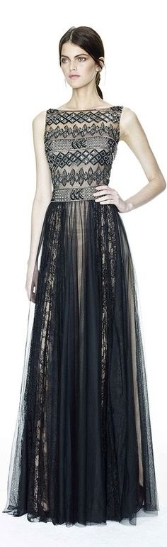 Beautifully paneled black chiffon gown with gold and silver detailing. I especially love the almost aztec inspired embellished torso and the belted feature.