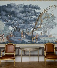 cognac-colored leather on gilt chairs, grey paint, tapestry-like wall paper
