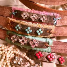 Wrapping and sewing!  Sari silk adds splashes of color to some leather bracelets...