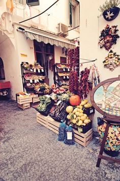 OLV 1st kitchen w/ cabinets, filled with spices and fruits etc, lemoncello, pickled veggies, etc  Amalfi coast, italy