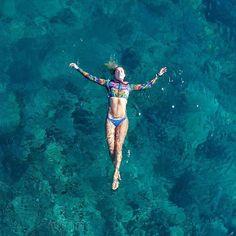 Ashley Baxter @ashbax808 floating above the reef in the big beautiful Ocean by karimiliya