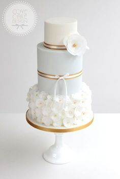 Pale blue and gold wedding cake with wafer paper flowers #weddingcakes