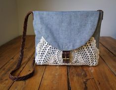NZFINCH boho bag, brown leather, denim and vintage doily    Made from upcycled leather and a faded blue denim with a vintage lace doily wrapped around the base