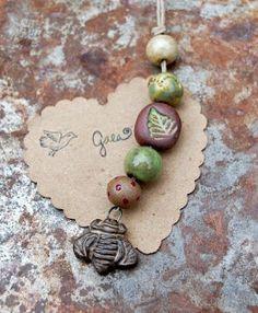 Ceramic carpenter bee charm and bead set… Gaea Ceramic Bead and Art Studio Blog || Gaea.cc