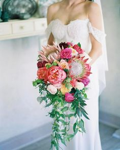 Protea and peony bouquet. Mix king protea heads with roses, peonies and trailing foliage for a more romantic look.  Image: Instagram/bloomingbridal #wedding #bouquet #protea