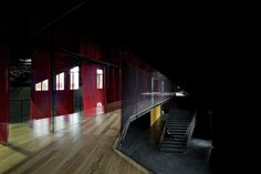 """Completed in 2015 in Santiago, Chile. Images by Nico Saieh, Maria Gonzalez. The design for this experimental performing arts hall proposed an """"emptying operation,"""" for which we used to our advantage the same municipal rules. Contemporary Architecture, Interior Architecture, Arch Interior, Interior Design, Dark Interiors, Landscape Design, The Selection, Backdrops, Stairs"""