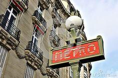Metro Sign And Street Lamp In Paris, Typical Parisian Building Facade. Art deco style Paris metro sign