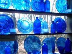 I collect cobalt blue glass, too, and have it in my kitchen window. This is a beautiful example of grouping for impact. I love blue.