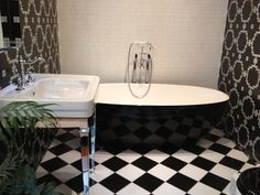 Trend Futurist and Liberty White on display in the Soak in Style Showroom + Sbordoni Basin on Stand and Victoria & Albert Barcelona Piano Black