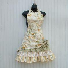 This is my Petticoat Ruffle Apron which has been featured on FOOD NETWORKS Cake Wars. With its ruffles and lace it is so fun to wear. The retro floral print is a heavier cotton for long wear. The pull-up with the flower show off the rows of lace and fabric ruffles and adds to that