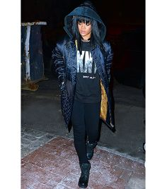 @Who What Wear - Rihanna                 Sporting a vintage Gianni Versace jacket and graphic DKNY Jeans Billboard Logo Tee ($40), the daring singer stylishly braved the cold in New York City last month. She polished off her look with black skinny jeans, lace-up boots, and a chunky-chain choker for an intriguing ensemble.