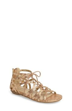 Free shipping and returns on Kenneth Cole New York Bright Ghillie Sandal (Walker, Toddler, Little Kid & Big Kid) at Nordstrom.com. Tiny crystals sparkle brightly from the slender cage straps of a lace-up sandal patterned in shimmery golden snakeskin.