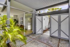 2096 Gird Road | Fallbrook, CA Mid-Century Modern Home Remodel Enter through the front door into an open air courtyard before walking into the home. This space brings the outdoor inside the home, while also offering privacy.