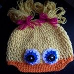 Crochet Girly Duck Hat- omg i love this! especially since i just found the magazine that has the crocheted ducky feet slippers in it!!!