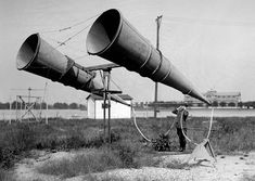 Using a two-horn listening device at Bolling Field in Washington D.C. in 1921 before the invention of radar to listen for distant aircraft. [1500x1064]