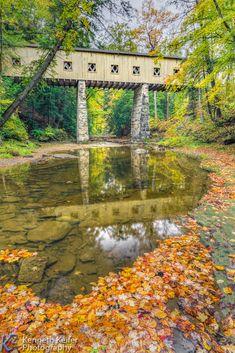 Windsor Mills Covered Bridge, seen here with beautiful fall foliage, is in Ashtabula County, Ohio.